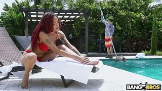 Sexy hot black nympho Julie Kay lures a pool boy and gives him head