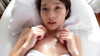 Caressing an oil covered Asian babe!