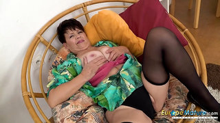 Watch this hot mature lady stroking her pussy while stripping down seductively Find this video on our network