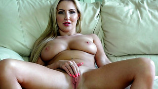 Sexually attractive mom Georgie Lyall plays with her wet pussy on the couch