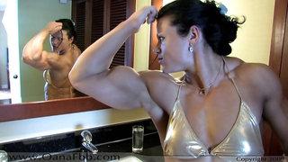 Huge female bodybuilder woshiping her biceps in mirror