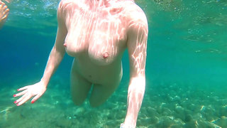 Ginger Gal with Big Natural Tits and Perfect Body Swimming Naked in Sea