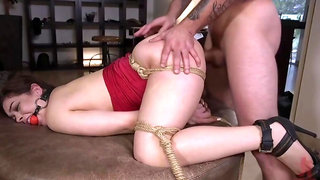 Brunette in red, Kimber Woods got tied up and gagged, before she got fucked in the ass