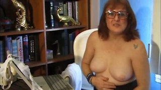 Maggie uses a ribbed dildo at the office