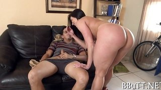 Big ass brunette beauty rides a thick schlong with pleasure