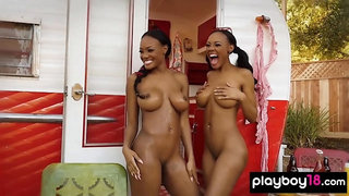 Black panther twins oiling their big boobs outdoor