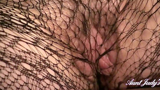 Aunt Judy's - Tess Fishnet Stockings Couch Masturbation