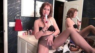 American milf Justine pleasures her hairy pussy