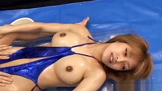 Asian lesbian rubs babe