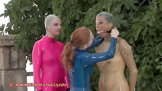 Latex Girls Play in Swimming Pool