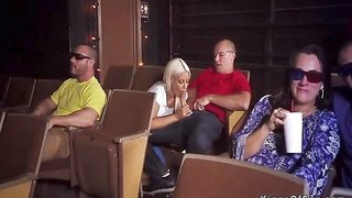 Blonde fucks strangers in cinema having some naughty fun in front of strangers