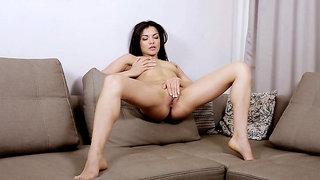 Russian MILF beauty Isha caresses her body