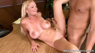 His horny man tool bangs naughty blonde Leah Lust on the desk