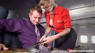 Tattooed flight attendant gives a guy in first class some pussy
