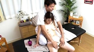 Busty Oriental cutie has a masseur plowing her aching cunt