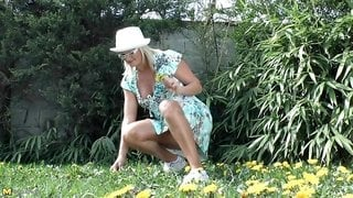 Watch this naughty gardener masturbates while fisting her cave outside