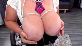 Busty brunette ties up her boobs