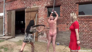 Dude tied up in the outdoors and spanked by girls