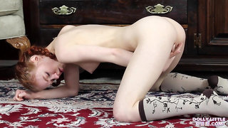 Redhead babe is masturbating with a vibrator