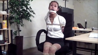 Drea chairtied, balgagged and drooling