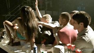 Amazingly sexy club hostess entertaining guys at the bar