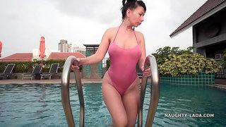 Beautiful asian girl in the pool