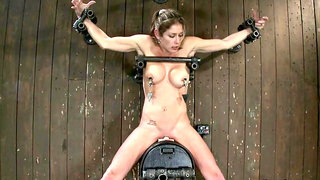 Shackled busty slave squirts on Sybian