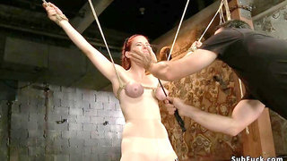 Busty slave is gagged and anal plugged