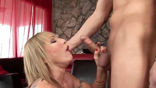 Raunchy MILF with big boobs gets screwed on the couch