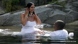 Bride gets busy with the BBC while in the water