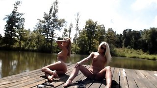 Two sensual teens show off their sexy bodies under the sun