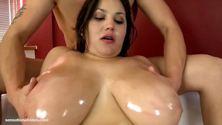 Voluptuous brunette is slowly taking off her clothes and eagerly sucking dick to make it explode
