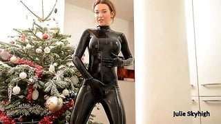 Kinky redhead in a tight black latex costume rubs her wet pussy on the floor while moaning