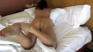 Wife on Hotel Bed