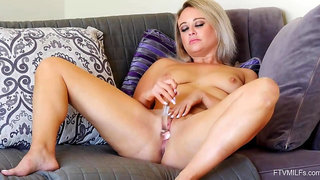 Blonde milf, Elle is naked and spreading her legs wide open to offer her wet pussy