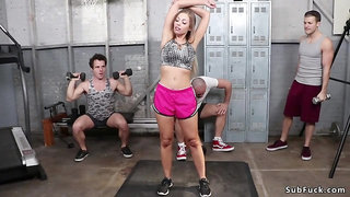Busty whore loves double penetration while gangbanged in gym in bondage