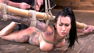 Inked chick is stripped naked and tied in some strict shibari