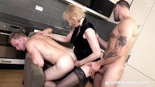 Wild a bit chubby blonde mature whore gives BJs to strong studs