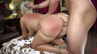 Bent over busty MILF Ryan Keely gets feet and ass slapped before hard doggy