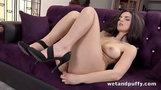 Stunning brunette Snowwhite plays with golden pussy beads