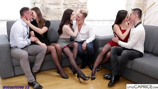 Three horny girls are fucking three handsome guys at the same time, on the couch