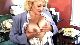 Dana pounds a dildo at the office