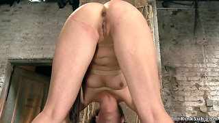 Brunette rides Sybian in suspension