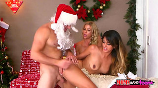 Santa fucks two hot pornstars in every single insane position