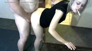 Sexy girl fucked doggystyle while smoking a cigarette