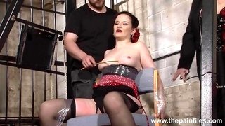 Tied up submissive MILF is sexually spanked by dominant couple