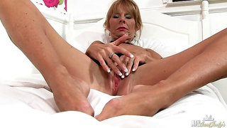 Cathy Oakley fucks herself with a toy.
