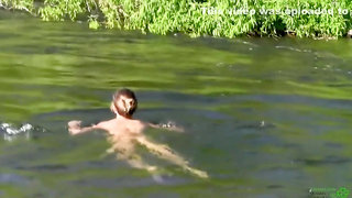 This woman loves to be nude in the river