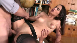 Slutty brunette fucked by two guys in library