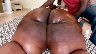 Obese Black Fatty gets her fat ass massaged - amateur porn